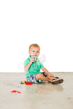 Child blowing soap bubbles in white background Royalty Free Stock Photos