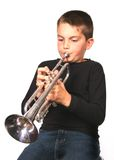 Child Blowing Trumpet. Kid blowing Horn Instrument royalty free stock image