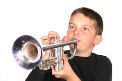 Child Blowing Trumpet stock image