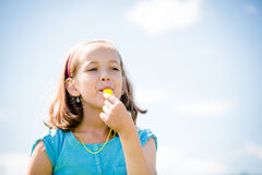 Child blowing whistle Royalty Free Stock Photography