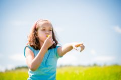 Child blowing whistle Royalty Free Stock Photo