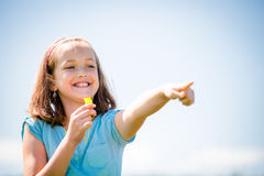 Child blowing whistle Stock Photography