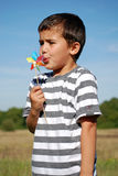 Child blowing windmill Royalty Free Stock Photo