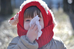 The child blows his nose in a napkin Stock Image