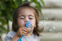Child Blows Soap Bubbles Stock Photo
