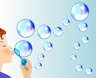 Child blows soapy bubbles Stock Photo