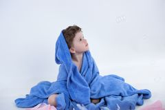 Child in blue Stock Photos