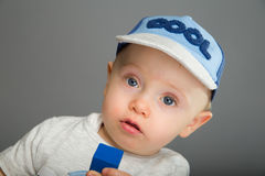 Child in blue cap Royalty Free Stock Image