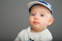 Child in blue cap Royalty Free Stock Images