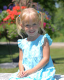 Child in blue dress Stock Images