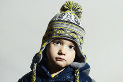 Child with blue eyes.fashion kids.fashionable little boy in winter cap Royalty Free Stock Photos