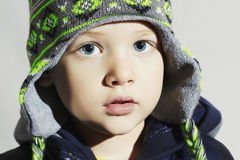 Child with blue eyes.fashion kids.fashionable little boy in winter cap Royalty Free Stock Photo