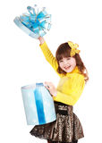 Child with blue gift box and butterfly. Stock Photo