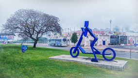Child on blue scooter in fog. Rishon LeZion, Israel-February 27, 2016: Blue metal sculpture of child on scooter by David Gabriely, Side view. The picture was Royalty Free Stock Photo