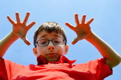 Child and blue sky Stock Photography