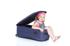 Child with blue suitcase Stock Image
