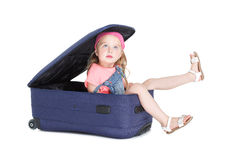 Child with blue suitcase Royalty Free Stock Images