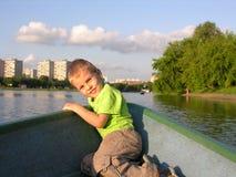 Child on boat stock image