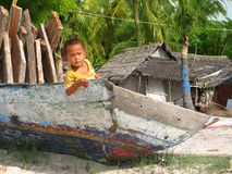 Child in the Boat in Nusa Lembongan Island Royalty Free Stock Images