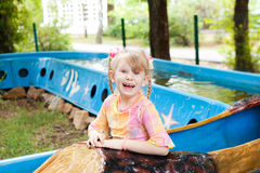 Child in the boat in the park Stock Image