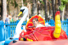 Child  in the  boat - swan rides in the park Royalty Free Stock Image