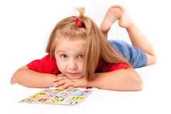Child with a book. Child girl with a book on the floor Stock Photos