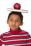 Child with Book and Apple Over His Head Stock Photography