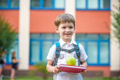 Child with book and green apple outdoors Royalty Free Stock Photo