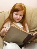 Child with book in hands Royalty Free Stock Image