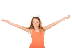 Child with a book on her head Stock Images