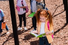 Child with book on playground Royalty Free Stock Photos