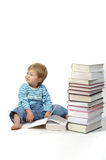 Child with books. Small child with a pile of books Stock Photography