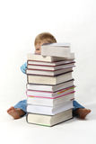 Child with books. Small child with a pile of books Stock Image
