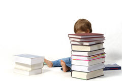 Child with books. Small child with a pile of books Stock Photos