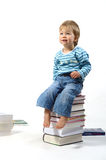 Child with books. Small child with a pile of books Royalty Free Stock Photos