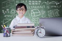 Child with books and notebook in class Stock Photography