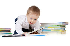 Child with books over white. Baby boy with books over white Royalty Free Stock Photo