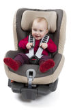 Child in booster seat for a car in light background Stock Image
