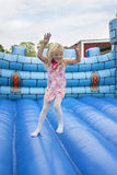 Child in bouncing castle. A 6 year old girl having fun on a bouncy mat Stock Image