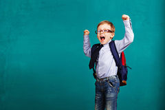Child bouncing into the classroom. Royalty Free Stock Photo