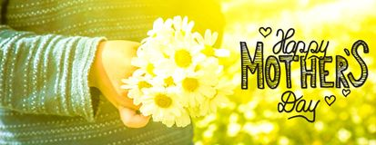 Child, Bouquet Of Daisy Flower, Calligraphy Happy Mothers Day. English Calligraphy Happy Mothers Day. Cute Little Kid Is Holding A Bouquet Of Daisy Flower. Sunny stock photography