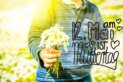 Child, Bouquet Of Daisy Flower, Calligraphy Muttertag Means Happy Mothers Day stock images