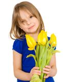 Child with a bouquet of flowers Stock Photography