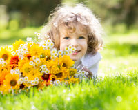 Child with bouquet of flowers Royalty Free Stock Photos