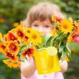 Child with bouquet of flowers Stock Photos