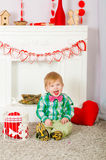 Child bow tie sitting near the fireplace Stock Image