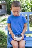Child with  bowl of blueberries Royalty Free Stock Photos