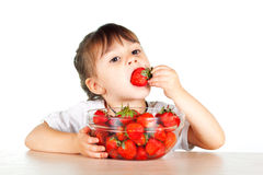 A child with a bowl fresh strawberries Royalty Free Stock Images