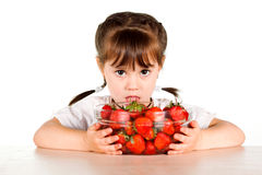 A child with a bowl fresh strawberries Stock Photos