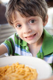 Child with a bowl of mac n cheese Stock Images